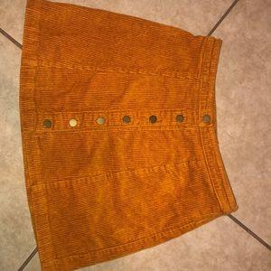 A orange skirt (never used)